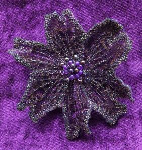 Machine embroidered velvet brooch